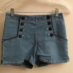 Tailored high-waisted shorts with button detailing